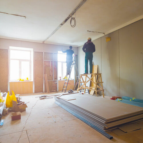 Contractors Work Inside a Home.