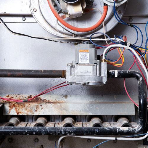 A Gas Furnace Open for Repair Service.