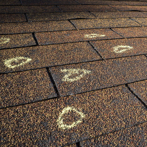 Storm Damage Roof Repair is Necessary for These Asphalt Shingles